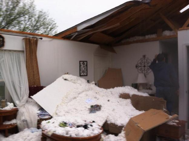 Photo of tornado damage to home